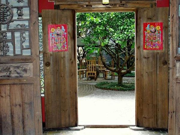 lobby-doors-yangshuo-village-inn-yangshuo-china-custom-1.jpg.1140x481 default